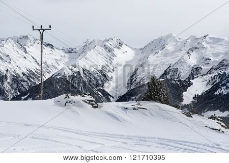 View on mountain ridge with electricity pole in the Alps, Austria