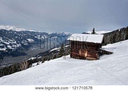 Wooden barn looking out over the valley of the Zillertal from Karspitz Mountain, Zillertal, Austria