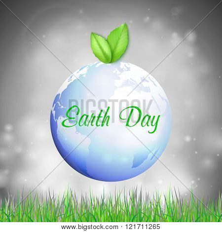 Earth Day background with the words, blue planet, green leaves and grass. Vector illustration