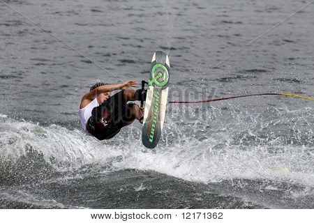 Putrajaya, MALAYSIA - 9 November. Waterskier Herman Beliakou in action in the shortboard/tricks event at the Waterski World Cup Competition.  9 November 2008 at the Putrajaya Lake in Malaysia.