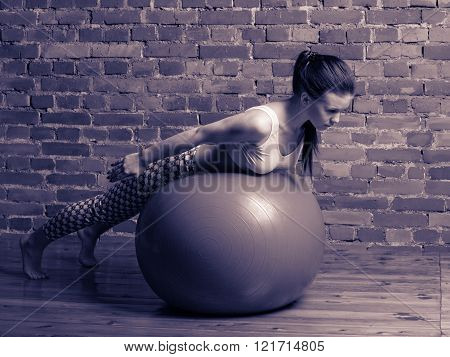 Young Brunette Woman Performing Hyperextensions