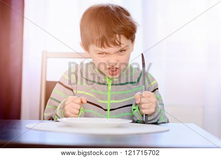 Angry Hungry Boy Child Waiting For Dinner