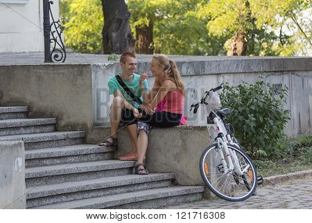 Odessa, Ukraine - August 28, 2015: Guy And The Girl Have A Rest In The Park