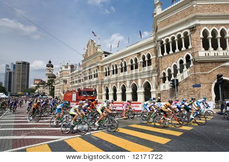 KL, MALAYSIA - 15 FEB: Cyclists in front of Sultan Abdul Samad Building during the le Tour de Langkawi race, Stage 7, KL Criterium. in Kuala Lumpur Malaysia 15 February 2009