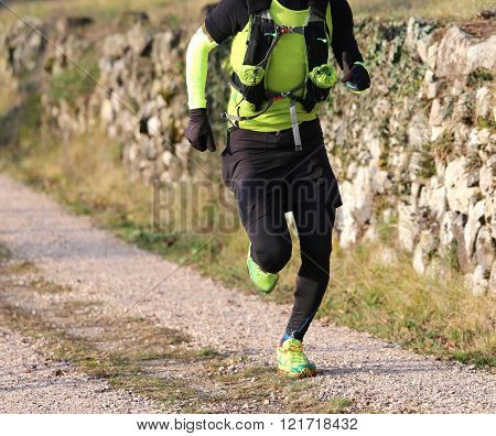 Runner With Sports Wear During Cross-country On A Country Lane