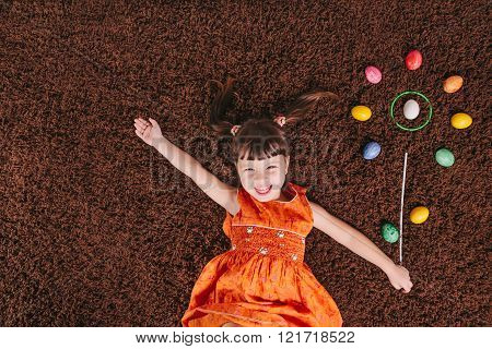 Happy Little Girls With Abstract Flower. Easter Aggs. Top View. Flat Lay.