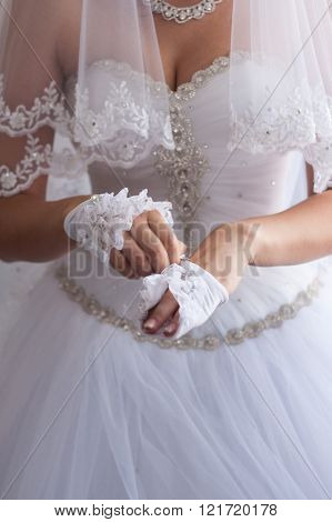 Bride Hands On Wedding Dress