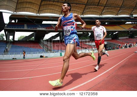 KUALA LUMPUR - AUGUST 15: Thailand's amputee athlete Sangat Chaikhini (L) runs at the track and field event of the fifth ASEAN Para Games August 15, 2009 in Kuala Lumpur.