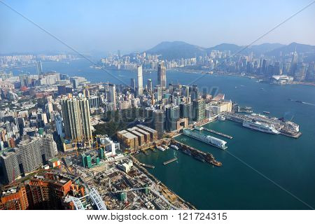 Hong Kong aerial view with urban skyscrapers boat and sea