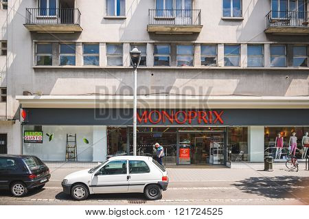 STRASBOURG FRANCE - MAY 23: Monoprix supermarket in the French city of Strasbourg on a warm spring day with customers entering and exiting store. Monoprix S.A. is a major French retail chain with its headquarters in Clichy Hauts-de-Seine France near Paris