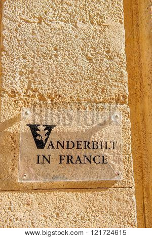 AIX-EN-PROVENCE FRANCE - JUL 17 2014: Vanderbilt in France University sign on typical Provence stone wall in the Provence city of Aix-En-Provence