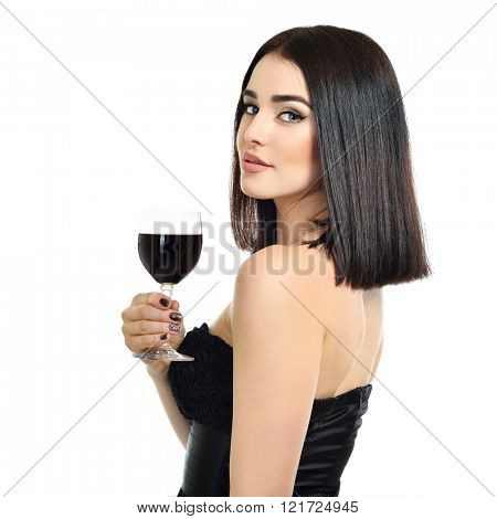 Portrait of beautiful young woman with glass of wine, over white background