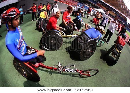 KUALA LUMPUR - AUGUST 16: ASEAN nations' wheel chair athletes gather before the race at the track and field event of the fifth ASEAN Para Games on August 16, 2009 in Kuala Lumpur, Malaysia.