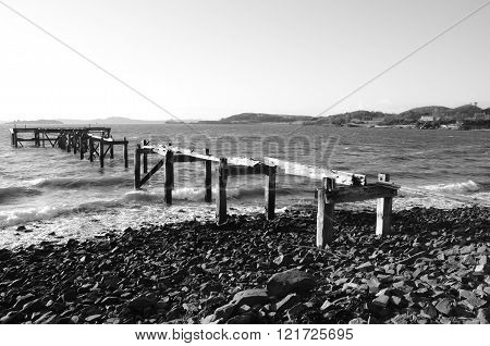 A view of an old wooden pier at Aberdour