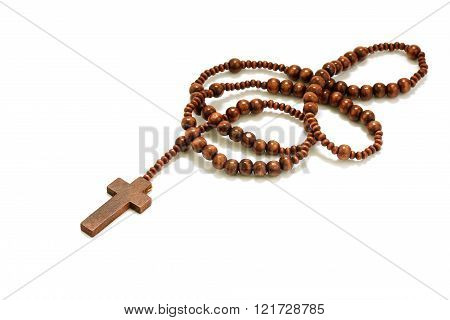 rosary beads with cross made of brown wood isolated on a white background, selected focus on christ