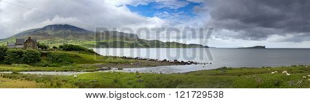 Panorama of a gathering storm in The Isle Of Skye. Uig Bay coastline, Trotternish Peninsula, Skye, Scottish Highlands.
