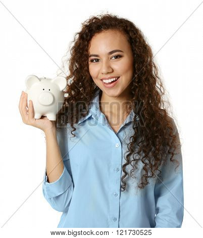 Beautiful young girl holding piggy bank, isolated on white