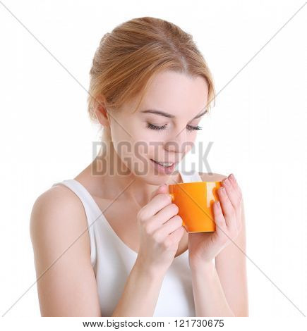 Beautiful girl enjoying a cup of tea, isolated on white