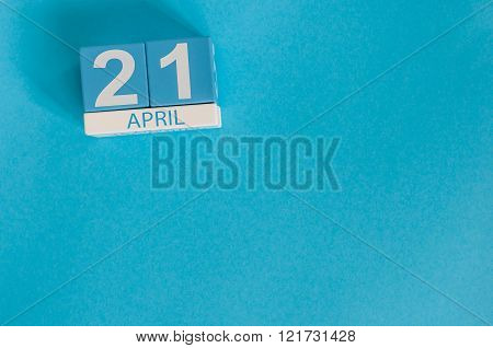 April 21st. Image of april 21 wooden color calendar on blue background.  Spring day, empty space for