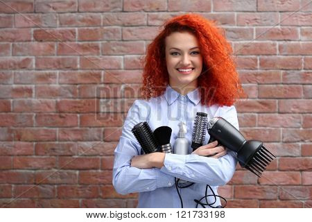 Red haired beautiful girl with barber accessories