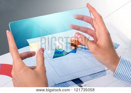 Woman's hands using glass tablet.