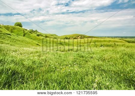 Green Hills On A Windy Summer Day
