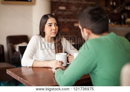 Pretty Girl Drinking Coffee With A Guy
