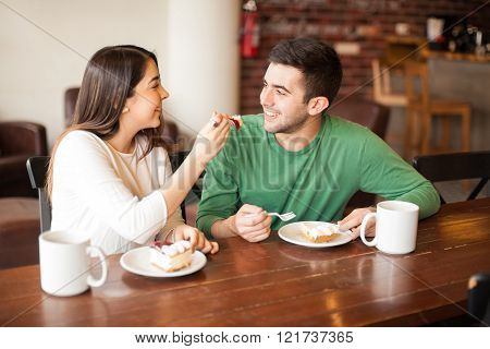 Attractive Young Couple Sharing Food
