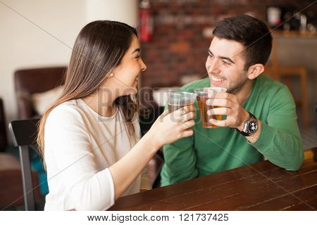 Couple drinking beer at a bar