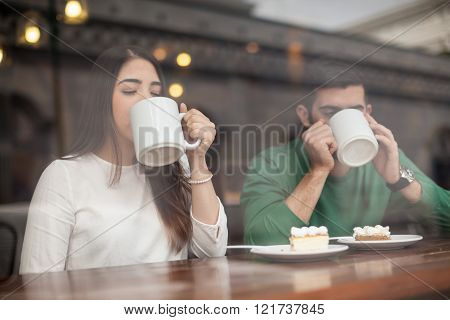 Young Couple Drinking Coffee On A Date