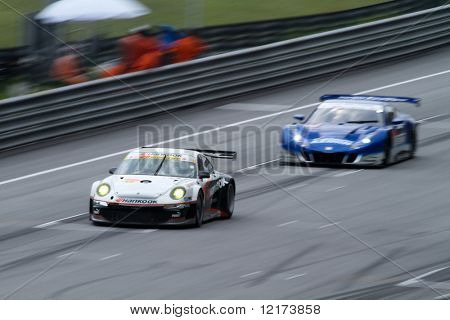 SEPANG, MALAYSIA - JUNE 21: The Hankook Porsche (33) in action at the Super GT International Series Round 4 race. June 21, 2010 in Sepang Malaysia.