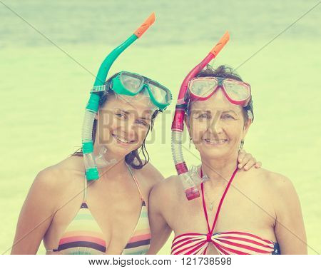 two woman with mask for snorkeling in the sea background