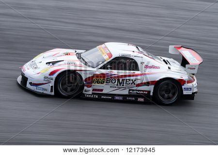 SEPANG, MALAYSIA - JUNE 21: The Bomex Lian Boxter car (666) in action during the Super GT International Series Round 4 race. June 21, 2010 in Sepang Malaysia.