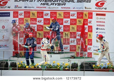 SEPANG, MALAYSIA - JUNE 21: The GT500 winners celebrating their win at the Super GT International Series Round 4 race. June 21, 2010 in Sepang Malaysia.