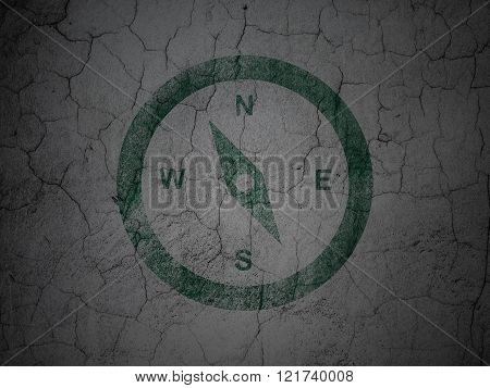 Travel concept: Compass on grunge wall background