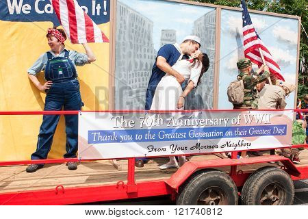ALPHARETTA, GA - AUGUST 2015:  A parade float with live characters pays tribute to Rosie Rivoter the Times Square kiss and the Iwo Jima flag planting to commemorate the 70th anniversary of World War II at the Old Soldiers Day Parade in Alpharetta, GA on A