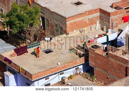 Local Woman Walking On A Flat Roof Of The House In Jaipur, Rajasthan, India
