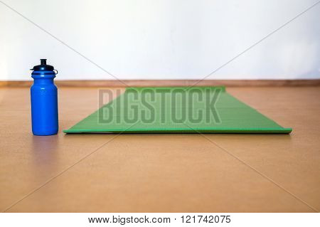 Yoga Mat, Water Bottle On Yellow  Background. Equipment For Yoga. Concept Healthy Lifestyle. Color.