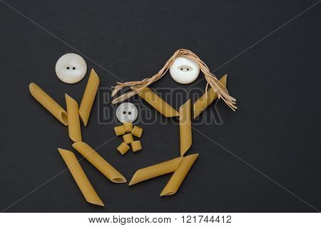 Pasta people family.  Father, mother and baby pasta people