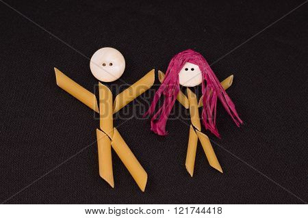 Pasta People holding hands celebrating.  Male and female holding hands