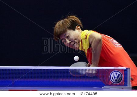 KUALA LUMPUR, MALAYSIA - SEPTEMBER 24: Guo Yan, China (ITTF World Ranking #3) serves an underspin ball at the Volkswagen 2010 Women's World Cup in table tennis on September 24, 2010 in Kuala Lumpur.