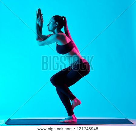 woman yoga exercices Garudasana eagle pose