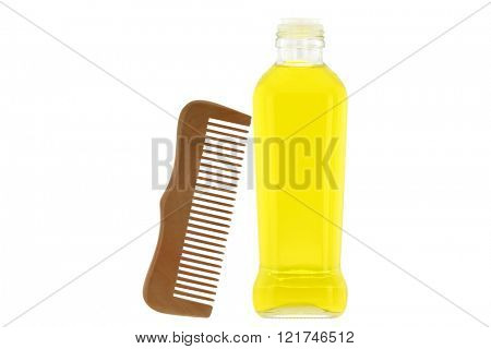 Bottle of olive oil and a wooden comb, amazing ingredient for skin and hair treatment isolated on white background