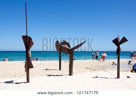 COTTESLOE,WA,AUSTRALIA-MARCH 12,2016: Metal sculpture display in the sand at the interactive arts festival on Cottesloe Beach in Cottesloe, Western Australia.