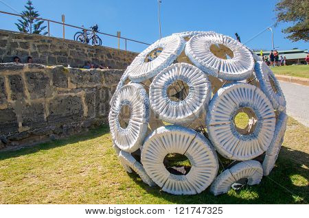 COTTESLOE,WA,AUSTRALIA-MARCH 12,2016: Spherical white sculpture at the interactive public arts festival Sculptures By The Sea on the foreshore at Cottesloe Beach in Cottesloe, Western Australia.