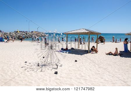 COTTESLOE,WA,AUSTRALIA-MARCH 12,2016: Metal abstract spherical sculpture with tourists at the