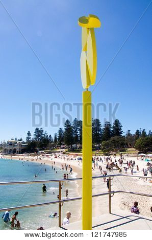 COTTESLOE,WA,AUSTRALIA-MARCH 12,2016: Yellow mobile sculpture with tourists at the