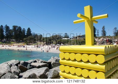 COTTESLOE,WA,AUSTRALIA-MARCH 12,2016: Bright yellow modern sculpture and tourists at the