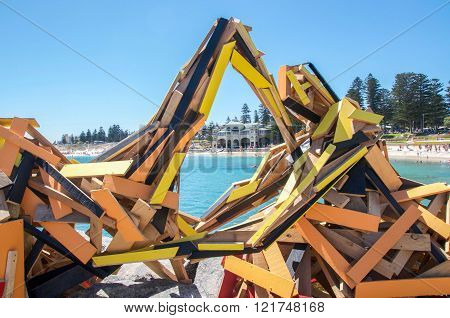 COTTESLOE,WA,AUSTRALIA-MARCH 12,2016: View of Indiana Tea House through wooden sculpture with tourists on the beach at the
