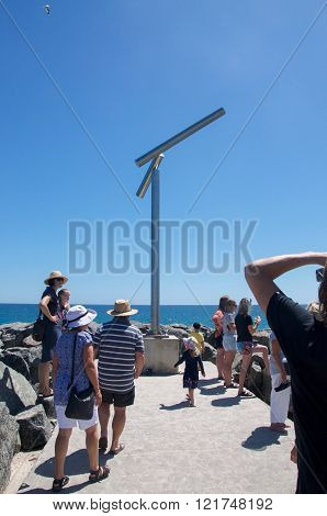COTTESLOE,WA,AUSTRALIA-MARCH 12,2016: Sculpture at the end of groyne overlooking the Indian Ocean with tourists at the